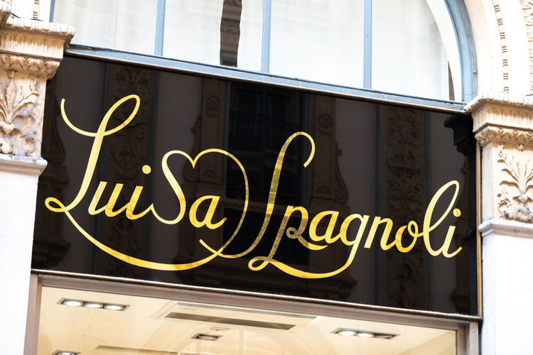 Luisa Spagnoli's shop signage. Luisa Spagnoli was an Italian businesswoman, famous for creating a brand of women's fashion clothing and chocolate brand Perugina Boutique Fashion Luisa Spagnoli Shopping Shopping Center Shopping ♡ Brand Close-up Clothing Shop Clothing Store Communication Influencer Italian Mall No People Outlet Retail  Retailer Shop Shopaholic Shopping Mall Shopping Time Store Text Western Script