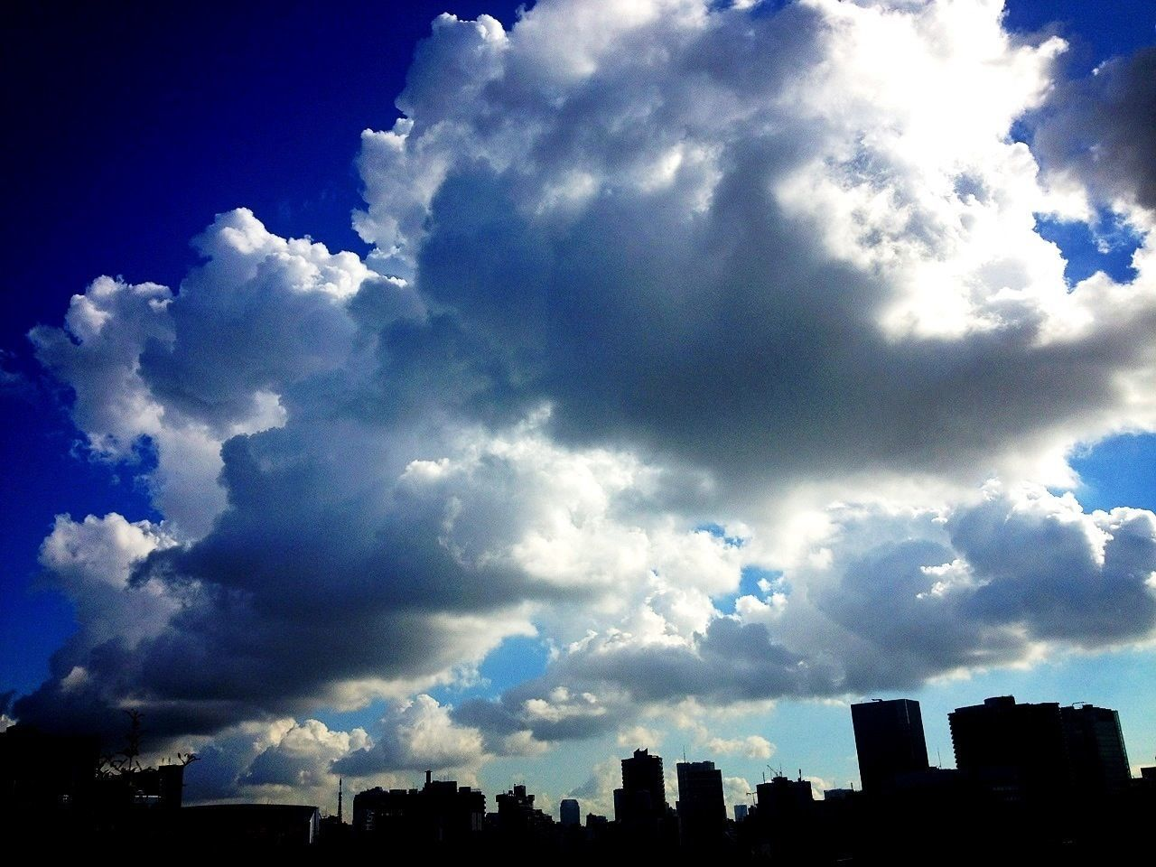 Cloudscape over city