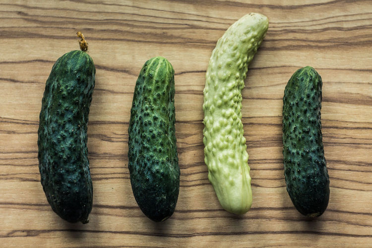 Close-up Cucumber Day Directly Above Food Food And Drink Freshness Fruit Green Color Healthy Eating High Angle View Indoors  No People Organic Raw Food Still Life Table Vegetable Wellbeing Wood - Material Wood Grain