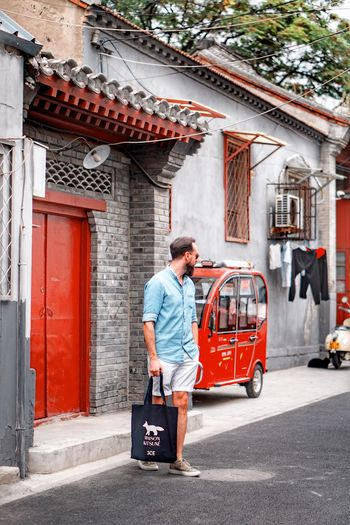 Architecture Built Structure One Person Building Exterior Transportation City Men Adult Mode Of Transportation Street Real People Males  Travel Day Full Length Walking Casual Clothing Lifestyles Building Outdoors
