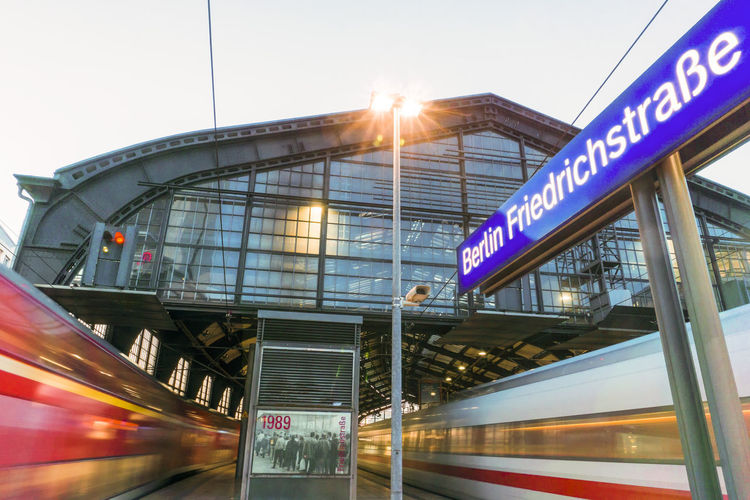 Two trains departing from Friedrichstrasse Station Berlin Friedrichstrasse Station Germany 🇩🇪 Deutschland Horizontal Simultaneous Twilight Architecture Blurred Motion Built Structure Communication Day Illuminated Motion No People Outdoors Public Transportation Rail Transportation Railroad Station Sky Speed Text Train - Vehicle Transportation