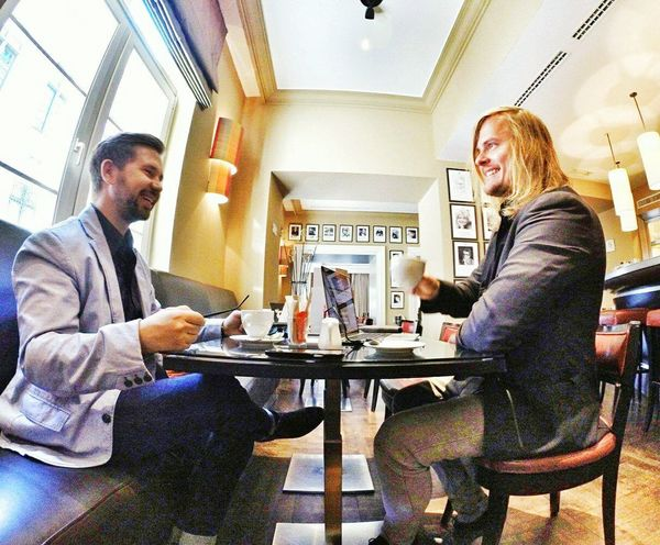 Young Adult Sitting Indoors  Holding Casual Clothing Person Smiling Front View Togetherness Confidence  Looking AxelandBoris Axelborisab Axel & Boris Entrepreneurs Visionaries Coffee Hotel Brussels