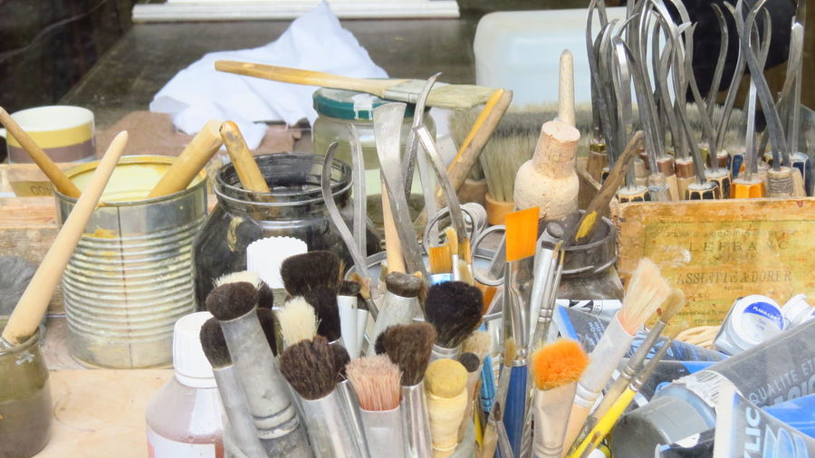 High Angle View Of Paintbrushes In Workshop