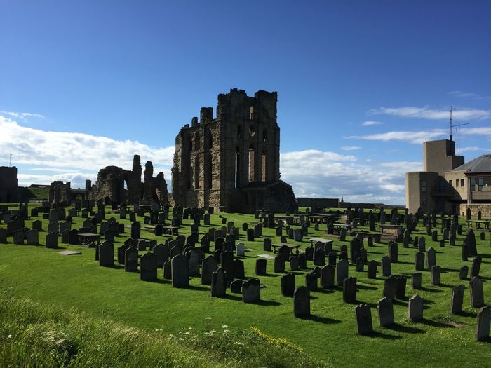 The ruins at Tynemouth Priory EyeEmNewHere Architecture Built Structure Cemetery Cloud - Sky Day Grass Grave Green Color History In A Row Memorial Nature No People North Shields Outdoors Plant Sky Stone Sunlight The Past Tombstone Tynemouth  Tynemouth Priory