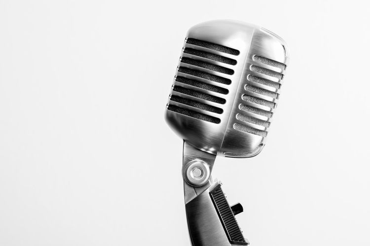 Close-Up Of Microphone Against White Background