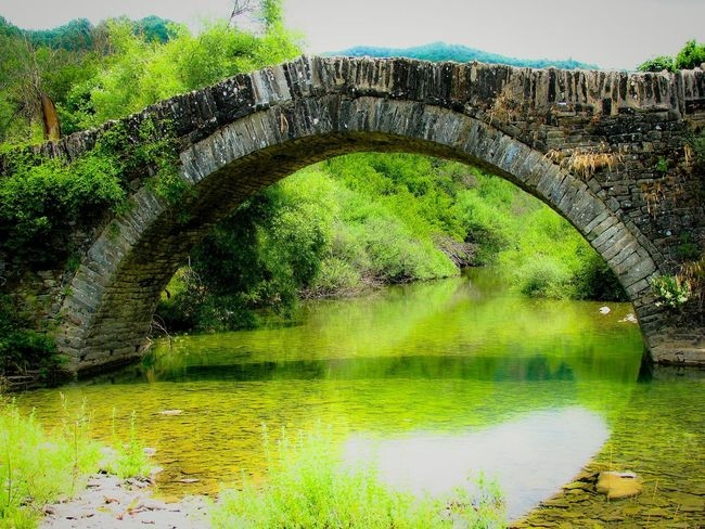 Bridge Stone Bridge Green Color Arch Bridge - Man Made Structure Architecture Water Tree Nature River Lost In The Landscape Beauty In Nature Medieval Medieval Architecture Ipiros Greece Old Old Buildings Old Bridge Transportation An Eye For Travel The Graphic City