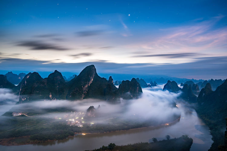 Heaven II XiangGong Mountain-相公山 Guilin, Guangxi, China 桂林漓江 Heaven Heaven On Earth Heaven And Earth Nightscape XiangGong Mountain Sky Scenics - Nature Beauty In Nature Mountain Tranquil Scene Cloud - Sky Water Tranquility Nature Sunset Long Exposure Idyllic Mountain Range Non-urban Scene No People Star - Space Motion Blurred Motion Night Mountain Peak