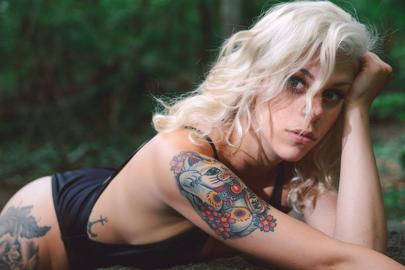Sensuous Tattooed Woman At Forest