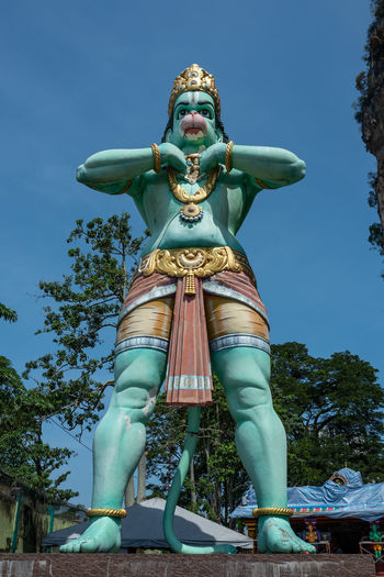 Kuala Lumpur Art And Craft Sculpture Representation Statue Human Representation Sky Low Angle View Creativity Day Male Likeness No People Nature Blue Religion Architecture Craft Spirituality Plant Belief Outdoors Batucaves