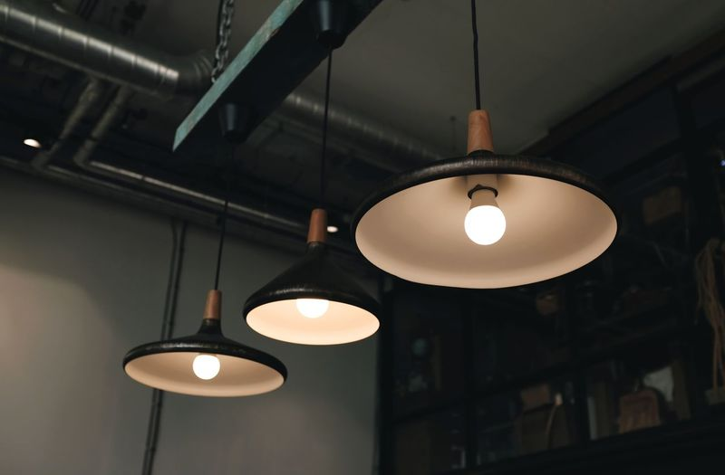 Low angle view of illuminated pendant light