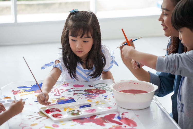 Kids painting on paper