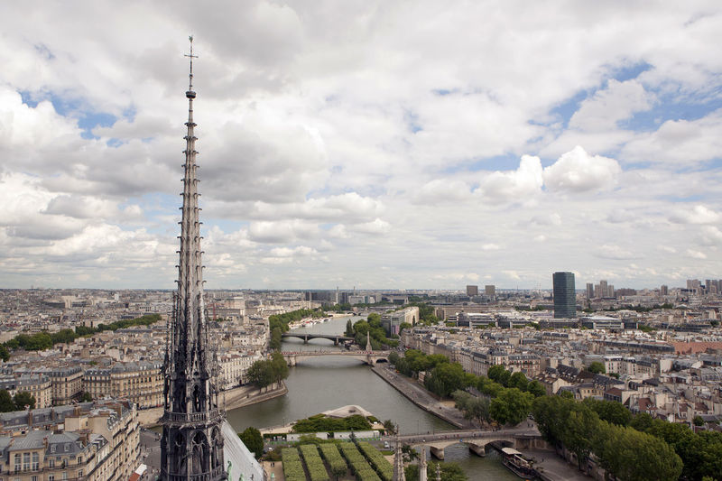 Notre Dame Spire recently destroyed by fire. Notre Dame De Paris Notre-Dame Architecture Built Structure Building Exterior Spire  High Angle View Cityscape Seine River View From Notre Dame Fire Religious Architecture Gothic Architecture Tall - High Sky Tower Cloud - Sky