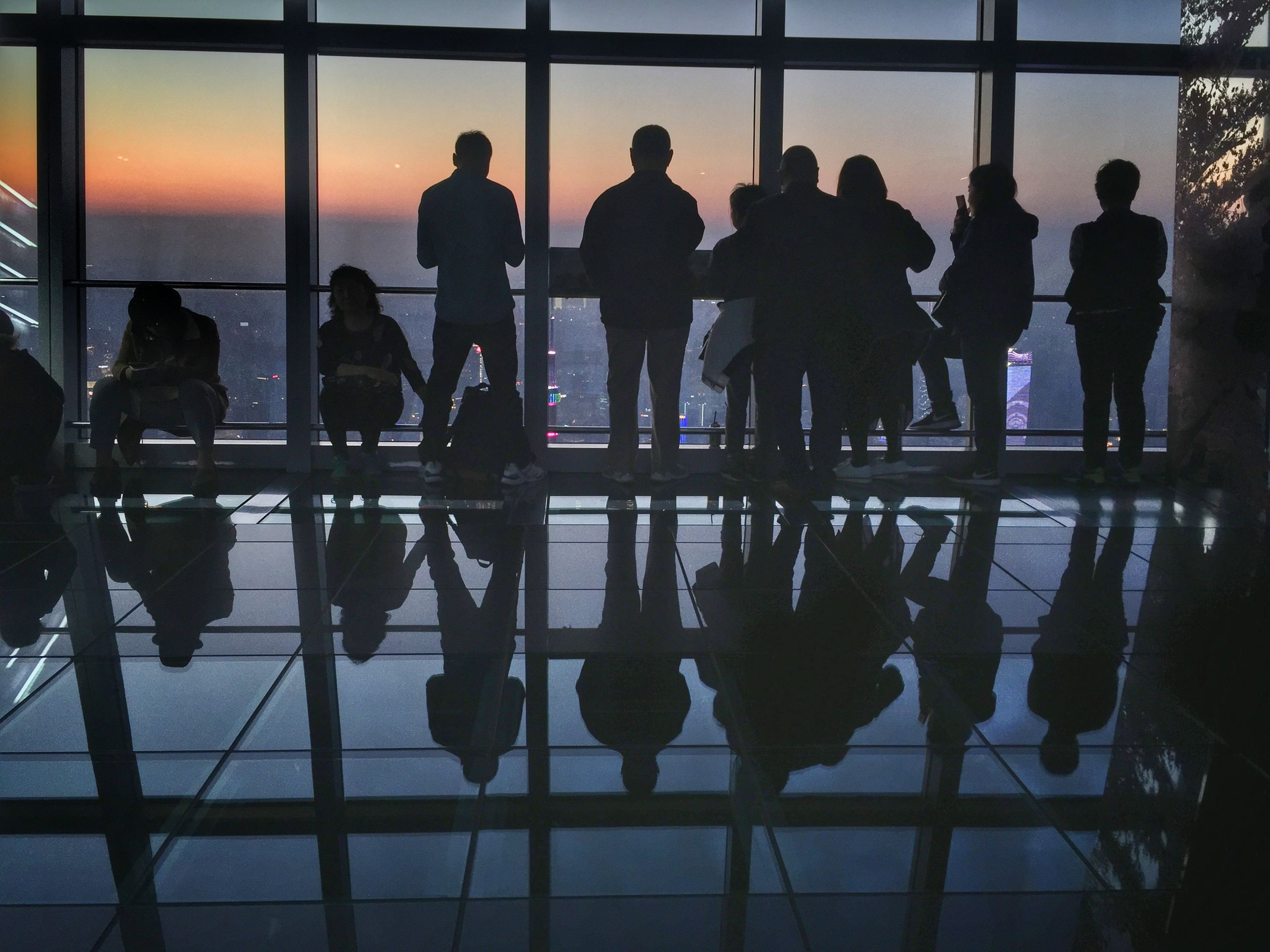 group of people, silhouette, real people, reflection, women, flooring, indoors, airport, group, people, adult, lifestyles, men, glass - material, travel, window, medium group of people, sunset, architecture, standing, tiled floor, waiting