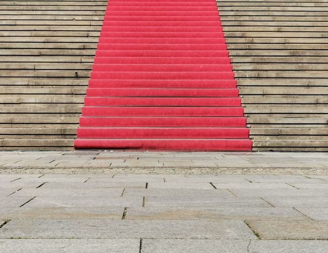 High angle view of red staircase on footpath