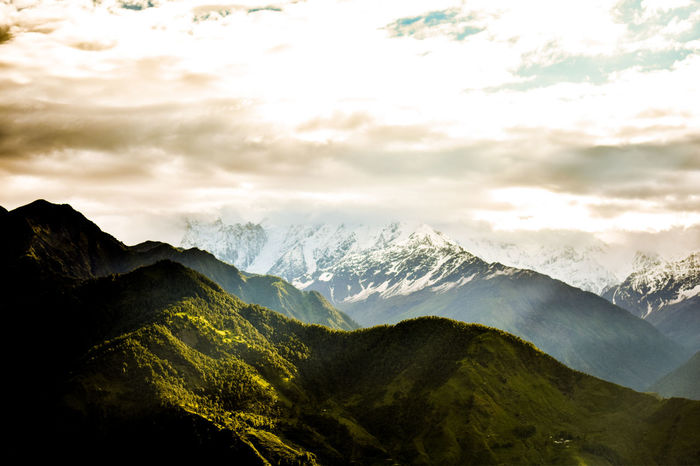 stunning scenic view of mountain under cloudy weather Idyllic Mountains And Sky Nature_collection Travel Destinations Tourism Incredible India Uttarakhand Munsyari Awesome Dramatic Landscape Majestic Adventure Backgrounds Beauty In Nature Landscape Mountain Mountain Range No People Outdoors Peak Scenics Sky Wallpaper Winter Shining