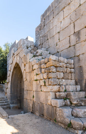 Destroyed steps leading to the fortress wall in Nimrod Fortress located in Upper Galilee in northern Israel on the border with Lebanon. Nimrod Fortress History Heritage Castle Fort Israel Saladin Beybars Crusaders Ayubids Mamluks Assassins Tower Travel Destinations Wall Stone Material National Park Tourism Hill Old Ancient Architecture Medieval Landmark Ruin Protection