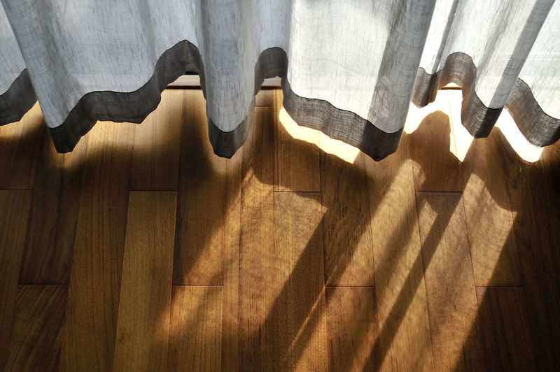 light shine through the curtain. Close up of draperies at a window. Day Design Empty Flooring Focus On Shadow Illuminated No People Side By Side Sunlight Tile