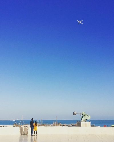Sea Water Beach Horizon Over Water Blue Incidental People Sand Clear Sky Nature Copy Space Day Scenics Beauty In Nature Real People Flying Sky Outdoors Vacations Men One Person