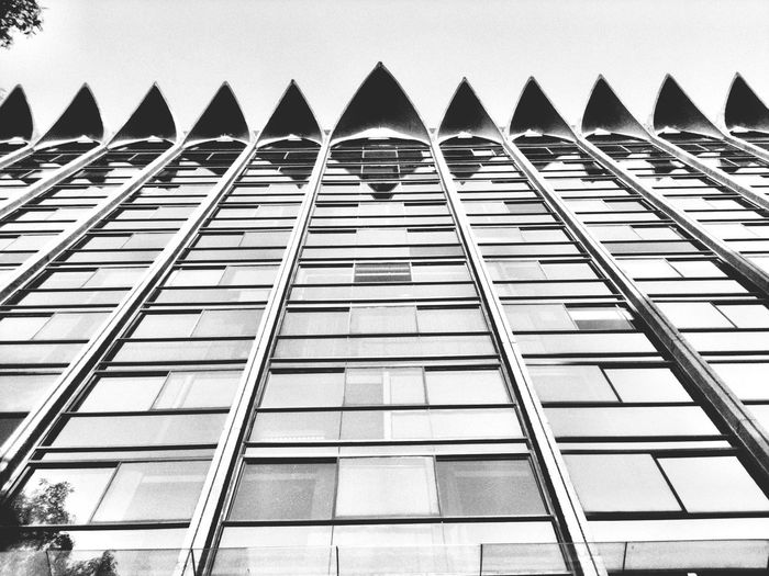 Upward View Of Building Facade With Spiky Roof