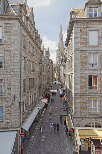 High angle view of Grand Rue with shops and restaurants in Saint-Malo, France Ancient Architecture Brick Brittany Building Exterior City City Life City Street France Gastronomy Grand Rue High Angle View House Intramuros Old Town Pedestrian Pedestrian Zone People Residential Building Saint-Malo Shopping Street Streetphotography Townhouse Travel Destinations