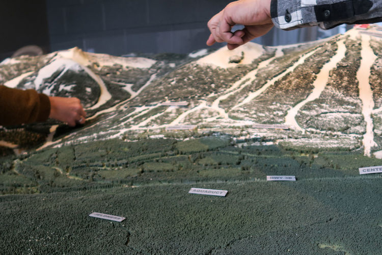 Adult Close-up Contstruction Hands Human Hand Map Maps Miniature Miniature Model Miniature Mountains People Red Mountain Ski Resort  Visualization Going Remote