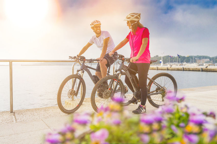 Couple with ebikes on tour in holidays Activity Adventure Bicycle Bike Couple Croatia Discover  E-bike E-mountain Ebike Electric Electric Bike Helmet Holiday Lifestyle Modern Mountainbike Pula Recreation  Seaside Summer Tour Unfiltered Vacations Woman