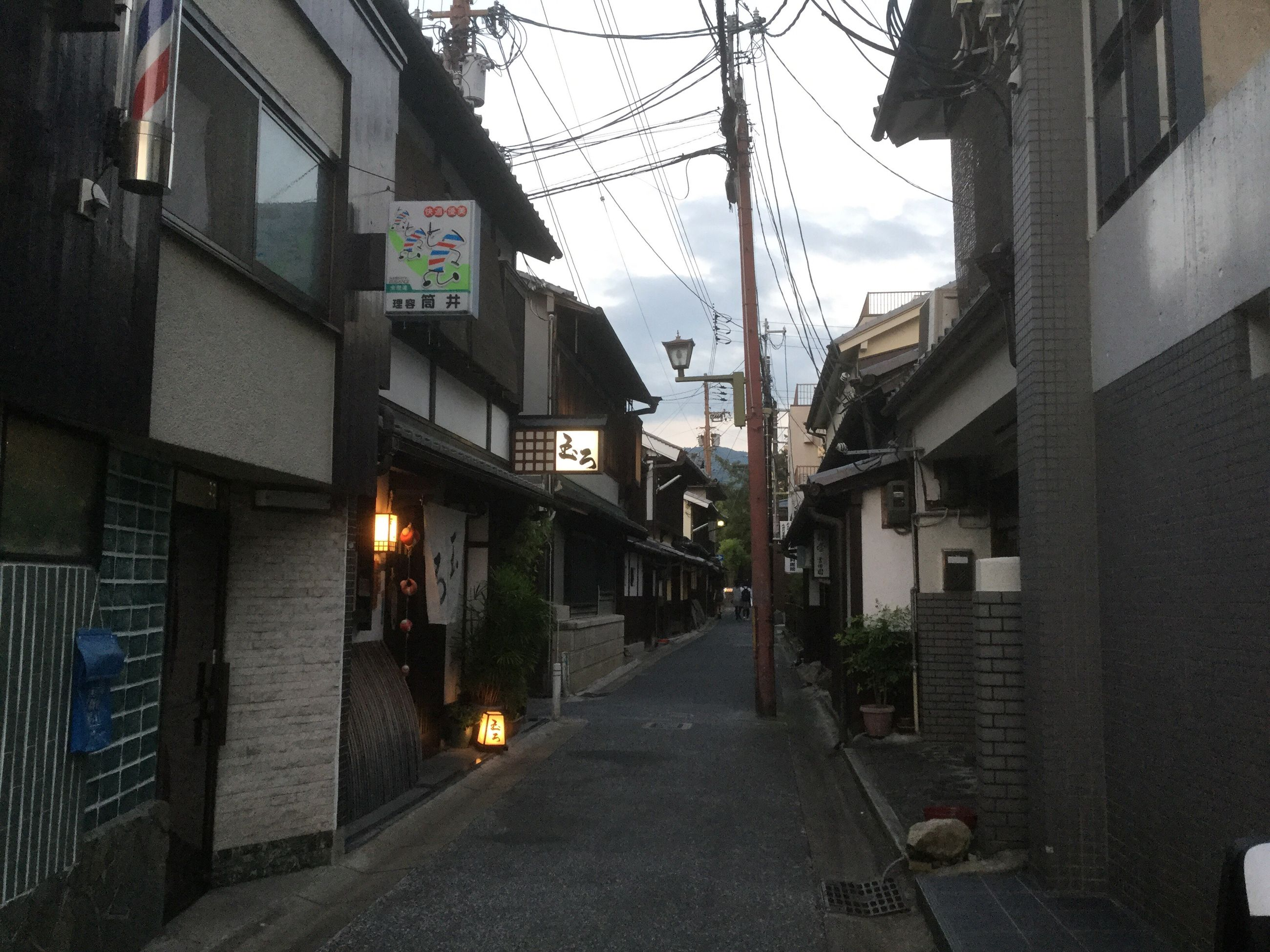 architecture, building exterior, built structure, street, the way forward, empty, road, long, narrow, residential building, residential structure, sky, city, pathway, footpath, outdoors, empty road, diminishing perspective, alley, no people