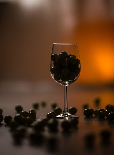 Close-up of black olives in glass on table