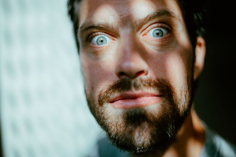Young man with scary facial expression Beard Facial Hair Portrait One Person Headshot Close-up Body Part Human Body Part Adult Young Adult Looking At Camera Men Human Face Young Men Emotion Mustache Contemplation Crazy Drugs Hallucinations Mental Health  Mental Illness Expression Eyes Scary