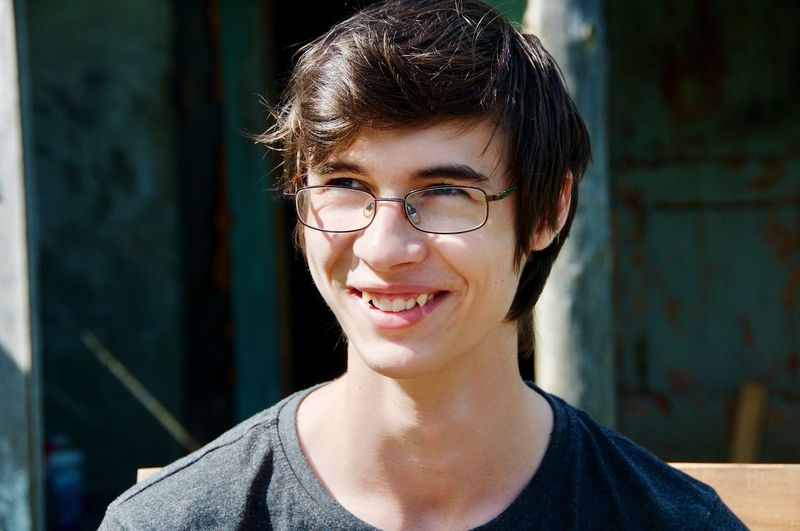 Portrait Looking At Camera Eyeglasses  One Person Smiling People Happiness Human Face Portraits Portrait Photography Glasses Juvinile Summer Cantry Youth Of Today Youth Young Young Men Day Smile