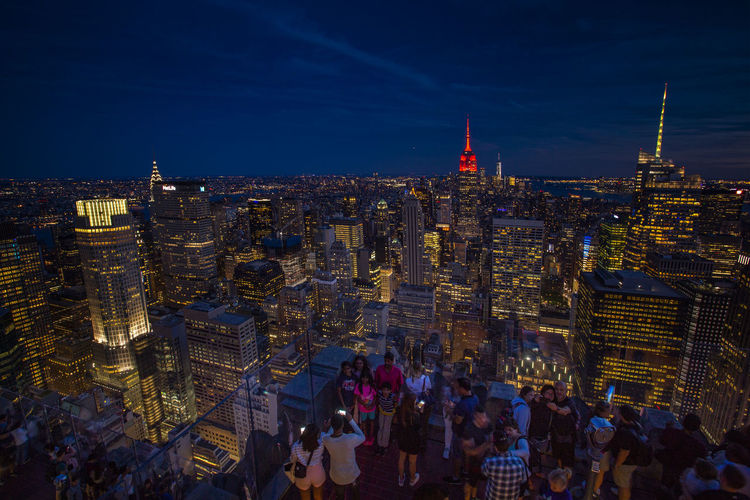 HUAWEI Photo Award: After Dark New York Nightphotography Architecture Building Building Exterior Built Structure City City Life Cityscape Crowd High Angle View Illuminated Large Group Of People Night Office Building Exterior Sky Skyscraper Spire  Tall - High Top Of The Rock Tourism Tower Travel Travel Destinations