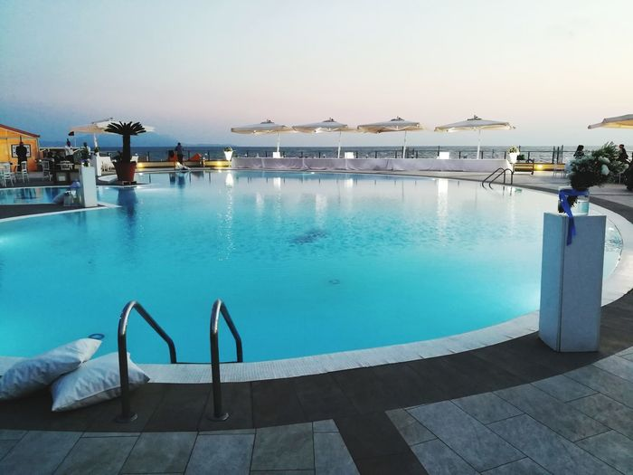 Swimming Pool Water Tourist Resort Vacations Relaxation Tranquility Luxury Sea Travel Destinations Leisure Activity Wealth Summer Tranquil Scene Reflection No People Swimming Luxury Hotel Day Outdoors Beach Wedding Day