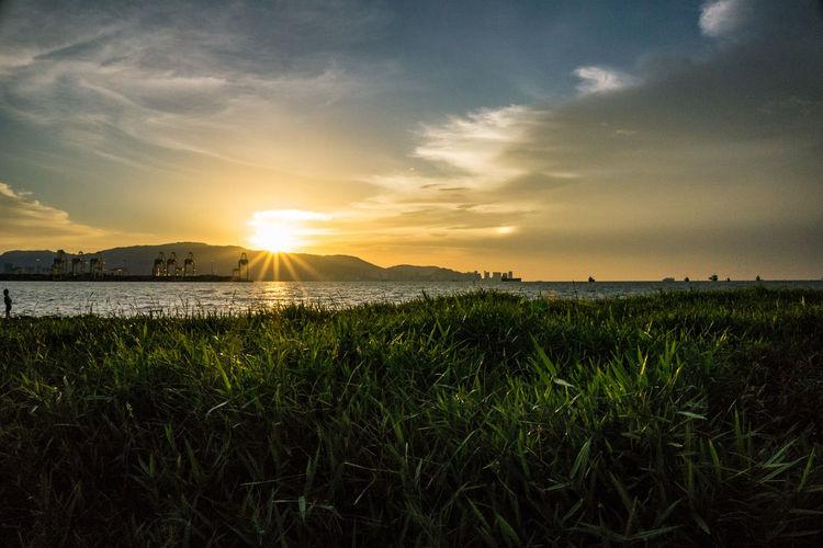 sunset Water Sunset Sea Sun Sky Grass Cloud - Sky EyeEmNewHere A New Beginning