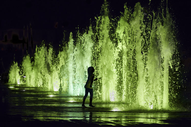 Play Green Colors Silhouette Child Childhood Color Fountain Lifestyles Motion Night One Person Outdoors Play Playing Real People Splashing Spraying Water Young Adult