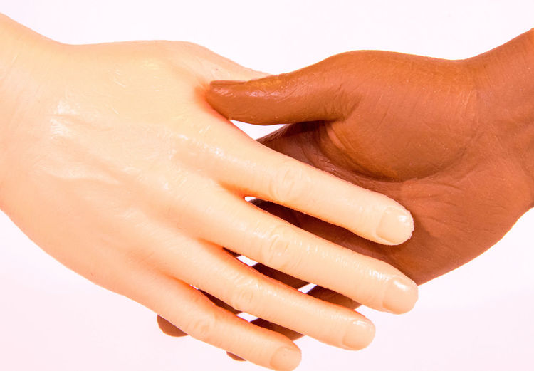 Close-up of woman hand over white background