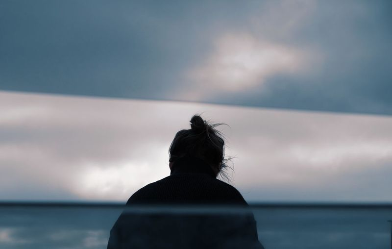 boat trip Travel Travel Photography Cloud - Sky Contemplation Dramatic Sky Headshot Horizon Horizon Over Water Looking At View Outdoors Rear View Sea Silhouette Sky Unrecognizable Person Water HUAWEI Photo Award: After Dark Autumn Mood