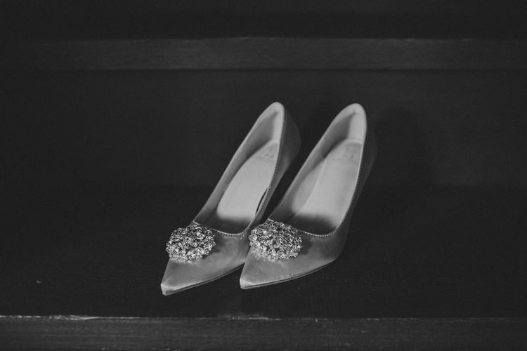 Close-up of shoes on table against black background