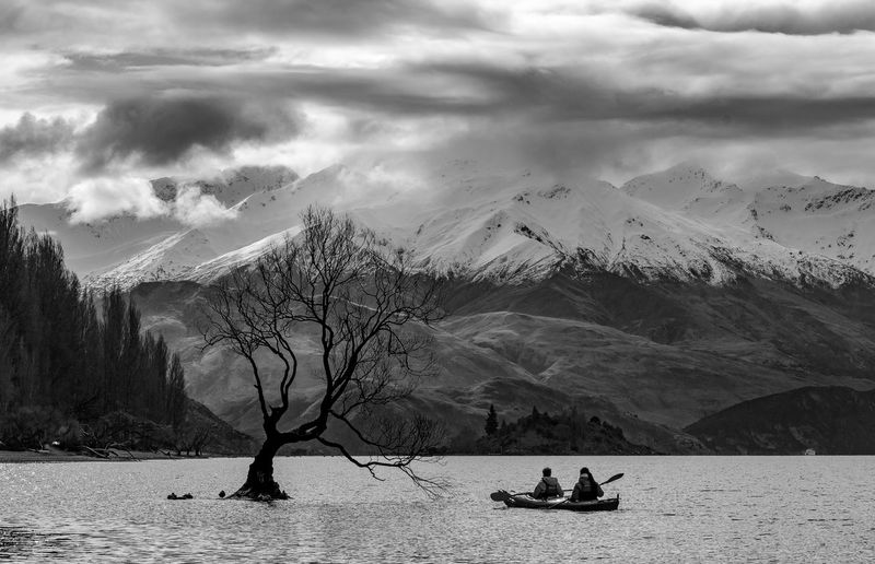 Mountain Beauty In Nature Cloud - Sky Scenics - Nature Sky Water Mountain Range Nature Real People Tranquil Scene Two People Waterfront Lifestyles Leisure Activity Non-urban Scene Day Tranquility Snow Snowcapped Mountain Outdoors Boat Cloudy Blackandwhite Tree Branch Wanaka That Wanaka Tree New Zealand New Zealand Scenery