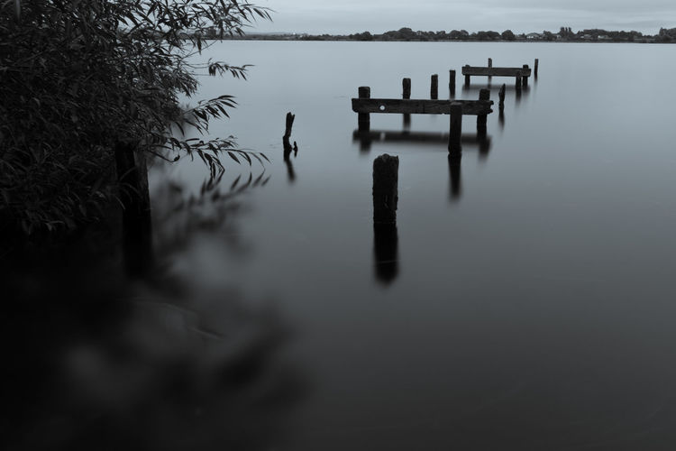 Gazebo in lake against sky