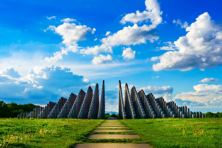 Stangenpyramide Sky Cloud - Sky Grass Nature No People Architecture Day In A Row Land Beauty In Nature Field Green Color Tranquil Scene Environment Tranquility Built Structure Travel Destinations History Outdoors Archaeology Treelined Landmark Dreieich Stangenpyramide Pillars