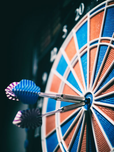 Close-up of darts on board