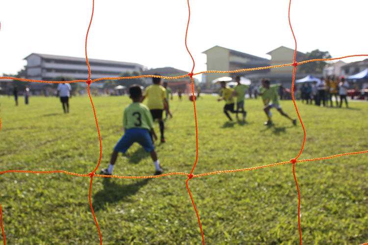 Children Playing Soccer On Field