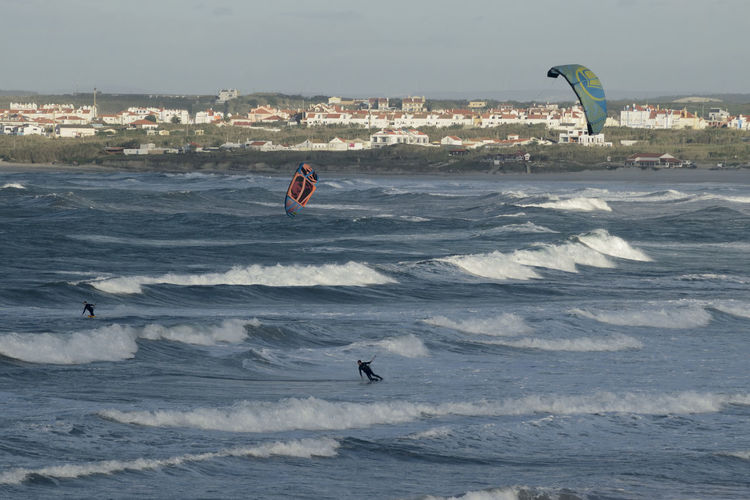 Kite surfers enjoy the wind and waves on Gamboa beach in Peniche Portugal. Adventure Beach Europe Extreme Extreme Sports Gamboa Kite Surfer Kite Surfers Kite Surfing Kiteboard Kiteboarder Kiteboarding Kitesurf Kitesurfer Kitesurfers Kitesurfing Leisure Activity Outdoors Peniche, Portugal People Sea Sport Waves, Ocean, Nature Wind