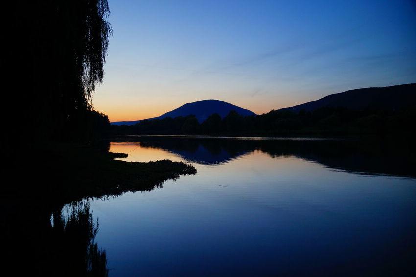 Twilight at the lake Calm Dark Silhouette Twilight Beauty In Nature Blue Clear Sky Lake Mountain Nature No People Outdoors Pilis Pilisszántó Reflection Relaxation Scenics Silhouette Sky Sunset Tranquil Scene Tranquility Tree Water Waterfront