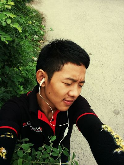 In-ear Headphones Listening Music Waist Up Black Hair Adult Adults Only One Person People Outdoors Technology Young Adult Day Only Men Human Body Part One Man Only SoeSat First Eyeem Photo