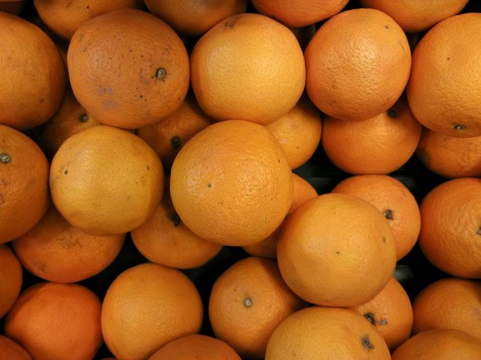 Directly above shot of oranges on market stall