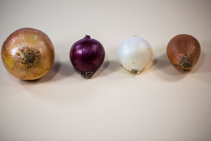 Onions, Different Onions Still Life Indoors  Studio Shot Freshness Food And Drink Food Healthy Eating No People Vegetable Wellbeing Close-up Onion White Background Copy Space Side By Side Table Group Of Objects Purple Choice Variation