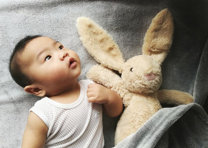 Close-Up Of Cute Baby With Easter Bunny At Home