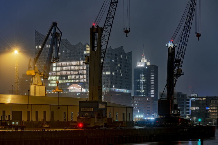 Elbphilharmony Long Exposure Nightphotography Hamburg Hafencity Elbe River Modern Architecture Architecture Building Exterior Illuminated Built Structure Machinery Crane - Construction Machinery Night City Sky Building No People Nature Industry Pier Harbor Water Commercial Dock Development Outdoors Office Building Exterior Cityscape Skyscraper Construction Equipment