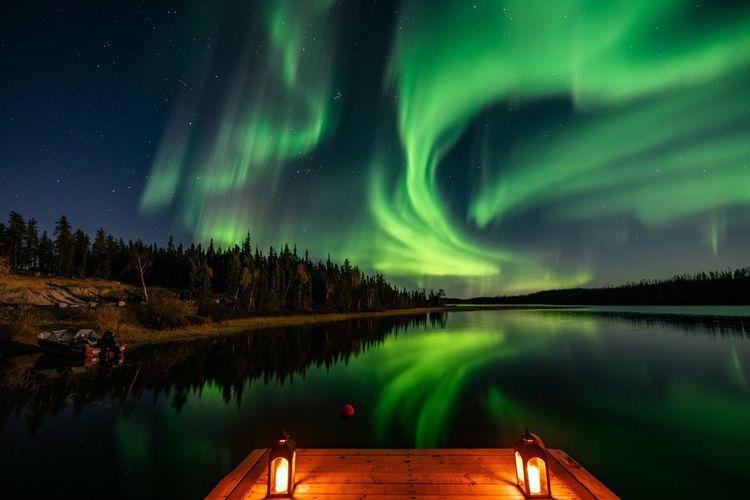 Scenic view of aurora polaris over lake at night